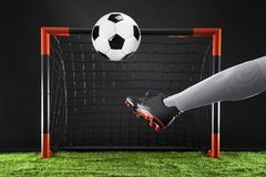Soccer. Championship concept with soccer player.Striker shooting on goal Royalty Free Stock Photo