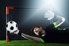 Goalkeeper defending a corner kick.Soccer. Fotball match.Championship concept with soccer ball. stock photos