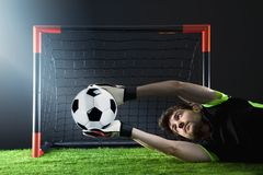 Goalkeeper defending a corner kick.Soccer. Fotball match.Championship concept with soccer ball. royalty free stock photo