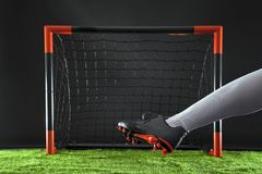 Soccer. Championship concept with soccer player.Striker shooting on goal Stock Photos