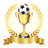 Soccer championship gold trophy. Soccer campionship gold trophy with golden banner and laurel on glowing background Royalty Free Illustration