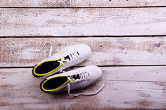 Soccer cleats against wooden background. Studio shot. Copy space Stock Photo