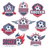 Soccer club, football sport game badge with ball. Soccer club, football sport game badge set. Soccer ball on heraldic shield with wing, flame, ribbon banner and Royalty Free Stock Images