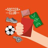 Soccer club hand holding red card ball sneaker whistle field t shirt equipment Stock Photo