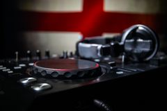 Soccer 2018 club party concept. Close up view of dj deck with selective focus. Useful as club poster. royalty free stock photography