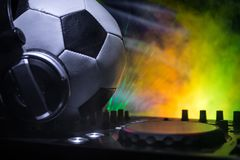 Soccer 2018 club party concept. Close up view of dj deck with selective focus. Useful as club poster. royalty free stock photo