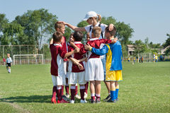 Soccer coach. With team kids Stock Photo