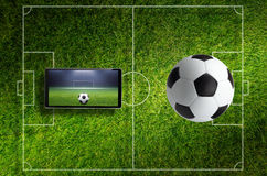 Soccer collage with ball, field and tablet pc Royalty Free Stock Image
