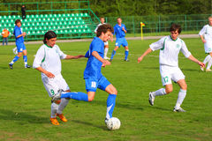 Soccer competition. Blue and white uniform. Sun weather.   in the Moscow. FK Zelenograd vs MVD Russia Stock Photo