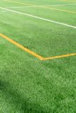 Soccer field with new artificial turf field. Close up. Soccer background. Copy space stock images
