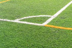 Soccer field with a new artificial turf field, white corner marking. Close up. Soccer background. Copy space stock image