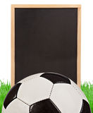 Soccer concept - grass, board and soccer ball Stock Images