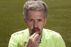 Soccer concept - man referee whistling pointing Royalty Free Stock Photos