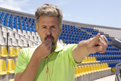 Soccer concept - man referee whistling pointing Stock Photo