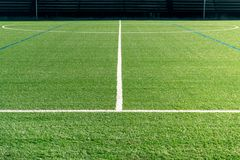 Soccer field with new artificial turf. Soccer background. Copy space royalty free stock photos