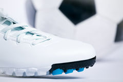 Soccer concept. Sport shoes and soccer ball. Stock Image