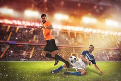 Soccer conflict scene between players at the stadium. Football action scene with competing football players at the stadium royalty free stock photo