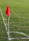 Soccer corner flag. Red corner flag on a soccer field royalty free stock photography