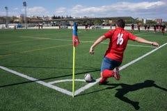 Soccer Corner Kick. Valencia, Spain - April 10, 2016: An unkown soccer player takes a corner kick during a men's soccer league game Stock Photos