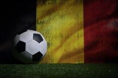 Soccer 2018. Creative concept. Soccer ball on green grass. Support Belgium team concept. Selective focus royalty free stock photos