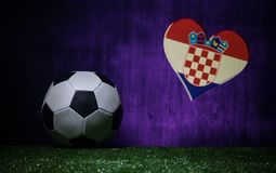 Soccer 2018. Creative concept. Soccer ball on green grass. Support Croatia team concept. Selective focus stock photography