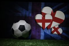 Soccer 2018. Creative concept. Soccer ball on green grass. Support England team concept. Selective focus Stock Image