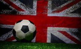 Soccer 2018. Creative concept. Soccer ball on green grass. Support England team concept. Selective focus Stock Photography