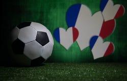 Soccer 2018. Creative concept. Soccer ball on green grass. Support France team concept. Selective focus stock photos