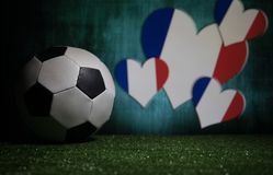Soccer 2018. Creative concept. Soccer ball on green grass. Support France team concept. Selective focus Royalty Free Stock Photo