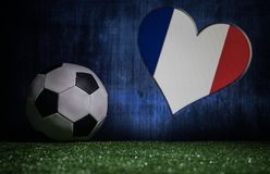 Soccer 2018. Creative concept. Soccer ball on green grass. Support France team concept. Selective focus Royalty Free Stock Image