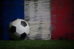 Soccer 2018. Creative concept. Soccer ball on green grass. Support France team concept. Selective focus Stock Photos