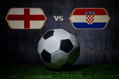 Soccer 2018. Creative concept. Soccer ball on green grass. England and Croatia. Selective focus Stock Image