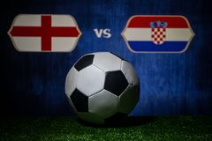 Soccer 2018. Creative concept. Soccer ball on green grass. England and Croatia. Selective focus Stock Photography