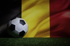 Soccer 2018. Creative concept. Soccer ball on green grass. Support Belgium team concept. Selective focus Stock Images