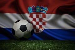 Soccer 2018. Creative concept. Soccer ball on green grass. Support Croatia team concept. Selective focus stock photos