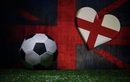 Soccer 2018. Creative concept. Soccer ball on green grass. Support England team concept. Selective focus royalty free stock photos