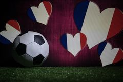 Soccer 2018. Creative concept. Soccer ball on green grass. Support France team concept. Selective focus Stock Images