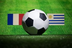 Soccer 2018. Creative concept. Soccer ball on green grass. Support your country or cheer concept. Selective focus Royalty Free Stock Photography
