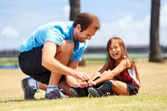 Soccer dad. And daughter practising in the field healthy sporty lifestyle royalty free stock photos