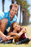 Soccer dad. And daughter practising in the field healthy sporty lifestyle stock photo