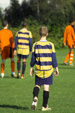 Soccer defender. Group of boys playing in a soccer match stock image