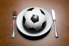 Soccer for dinner Stock Photography