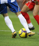 Soccer dribbling. Soccer player legs dribbling in a match Royalty Free Stock Photo
