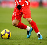 Soccer dribbling. Soccer player legs dribbling in a match Royalty Free Stock Images