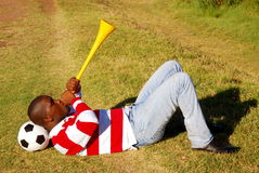 Soccer fan blowing Vuvuzela Royalty Free Stock Photography