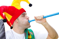 Soccer fan blowing vuvuzela Royalty Free Stock Photo