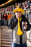 Soccer Fan Blows on Vuvuzela Horn Stock Photography