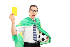 Soccer fan with Brazilian flag holding yellow card. Isolated on white background Stock Photo