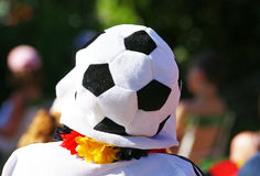 Soccer fan with football hat Stock Photos