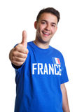Soccer fan from France showing thumb up Royalty Free Stock Images